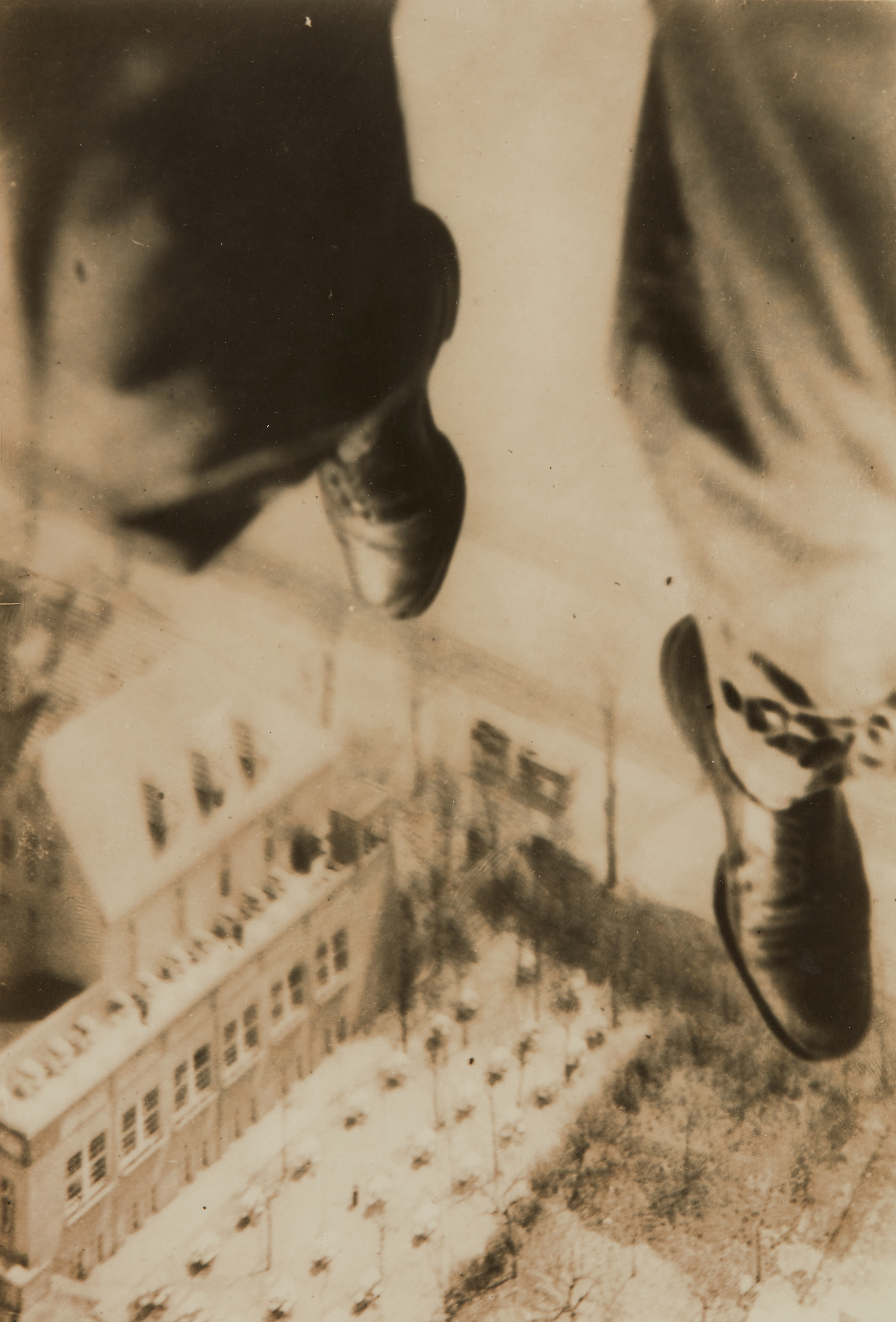 Berlin Fallschirmspringer, which translates as Berlin Parachute Jumper, from Willi Ruge's 1931 series, I Photograph Myself During a Parachute Jump.