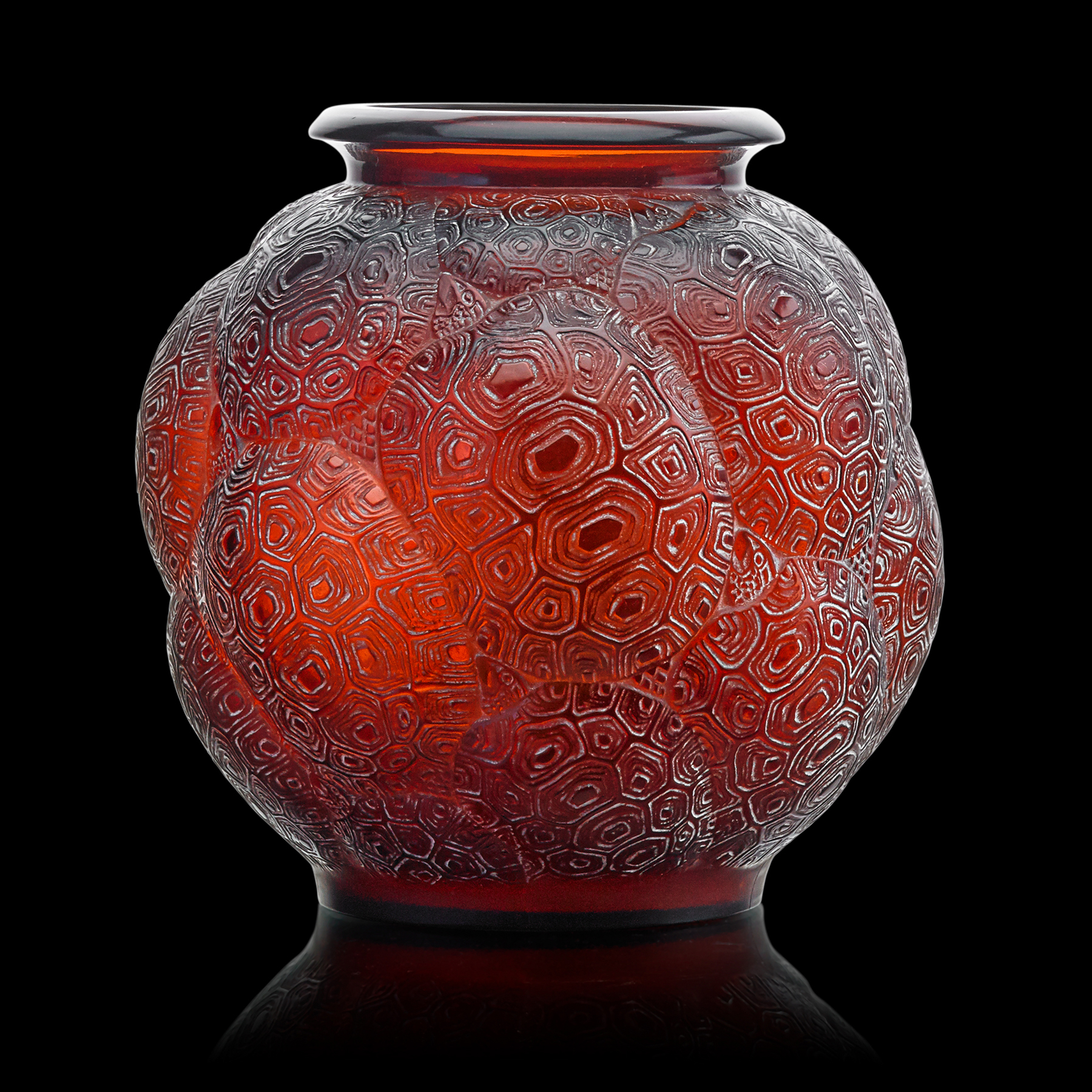 A Tortues (Turtles) vase by the French glass master and entrepreneur René Lalique, rendered in amber glass with a hand-applied white patina. It was designed in 1926 and produced between 1926 and 1945, when Lalique died.