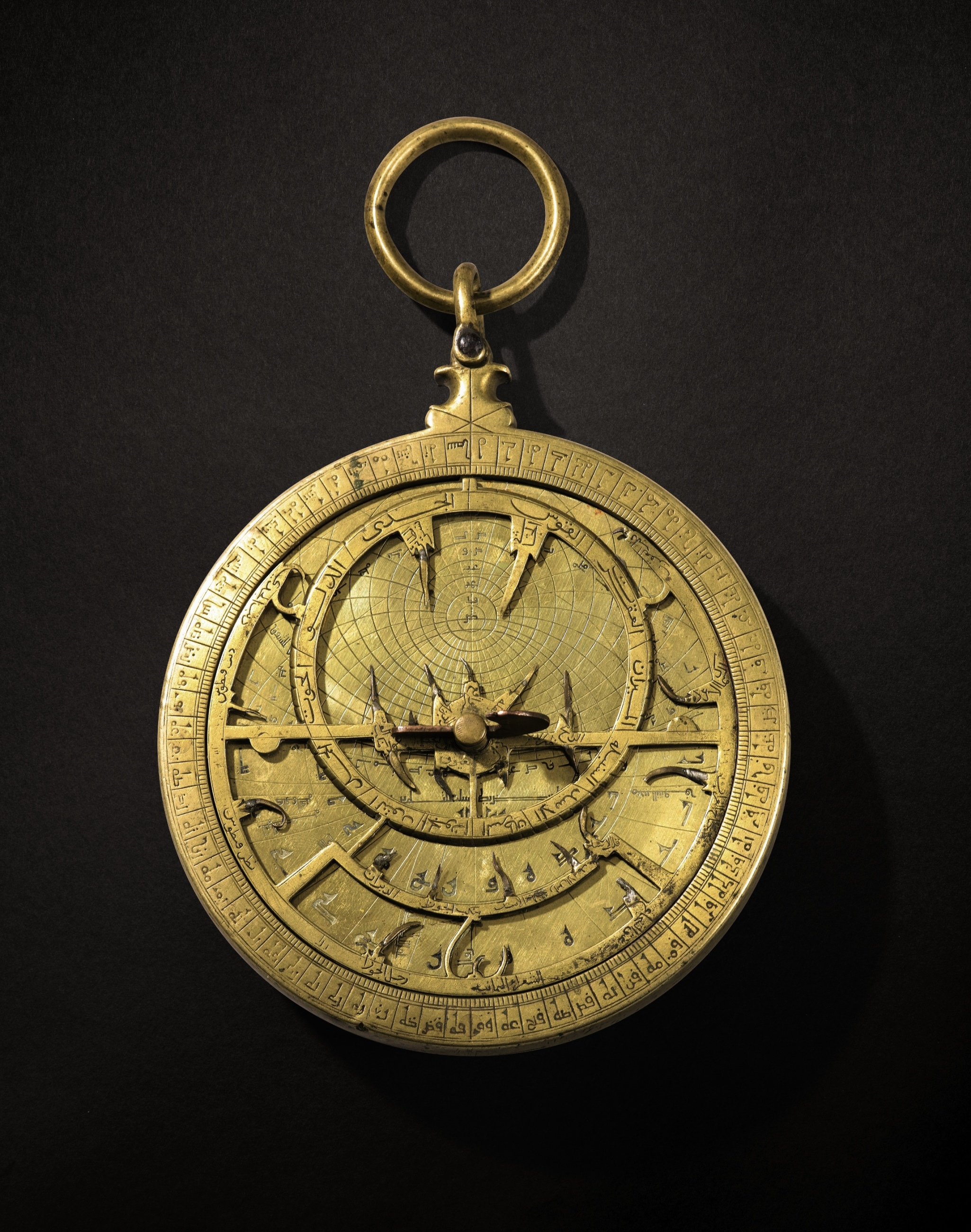 A rare Umayyad-era brass astrolabe, signed by Muhammad ibn al-Saffar and dated in Western Abjad 411 AH (1020 AD). It is the earliest known dated astrolabe from Muslim Spain. It comes from a French collection.