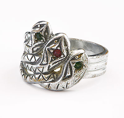 A silver-toned three-headed snake ring with red and green gemstones, made by Clyde Barrow during a prison stay at Eastham Prison Farm in Texas and later given to Bonnie Parker.