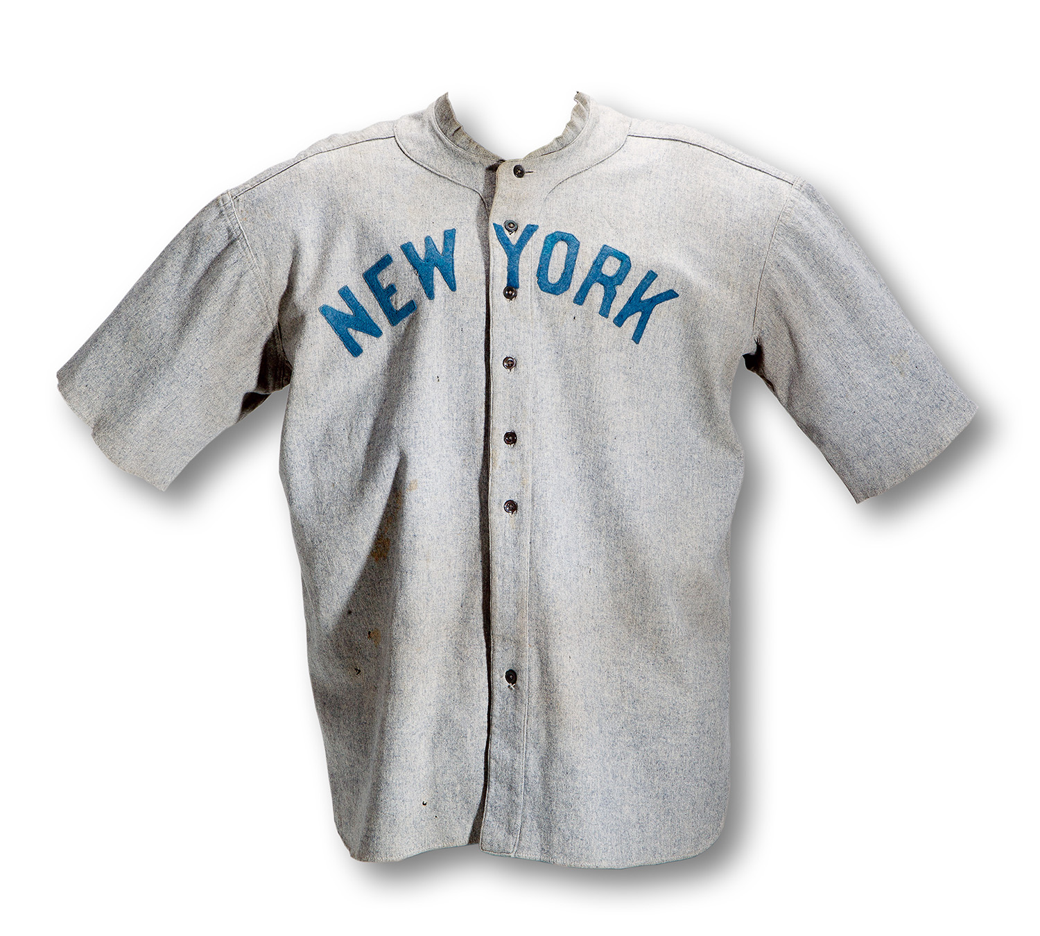 A road gray, game-worn New York Yankees jersey that was worn by Babe Ruth. SCP Auctions sold it for $4.4 million in May 2012, setting a then-record for any item of sports memorabilia at auction.