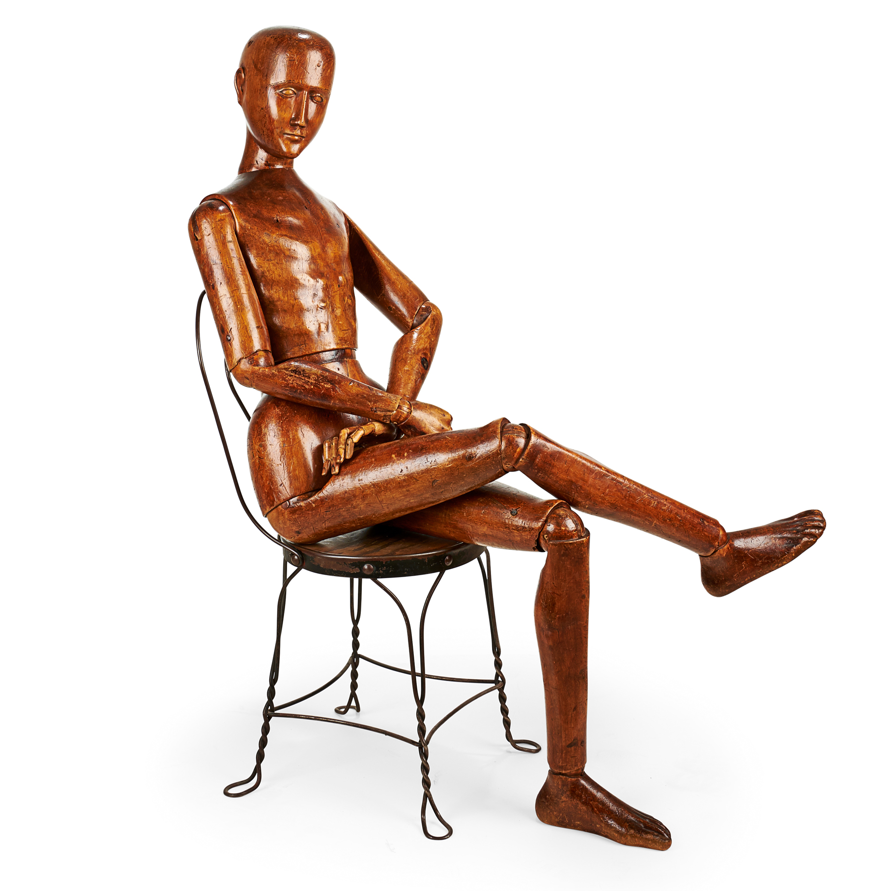A life-size articulated wooden artist's mannequin, made in France, dating to around 1860, and measuring about 60 inches tall.