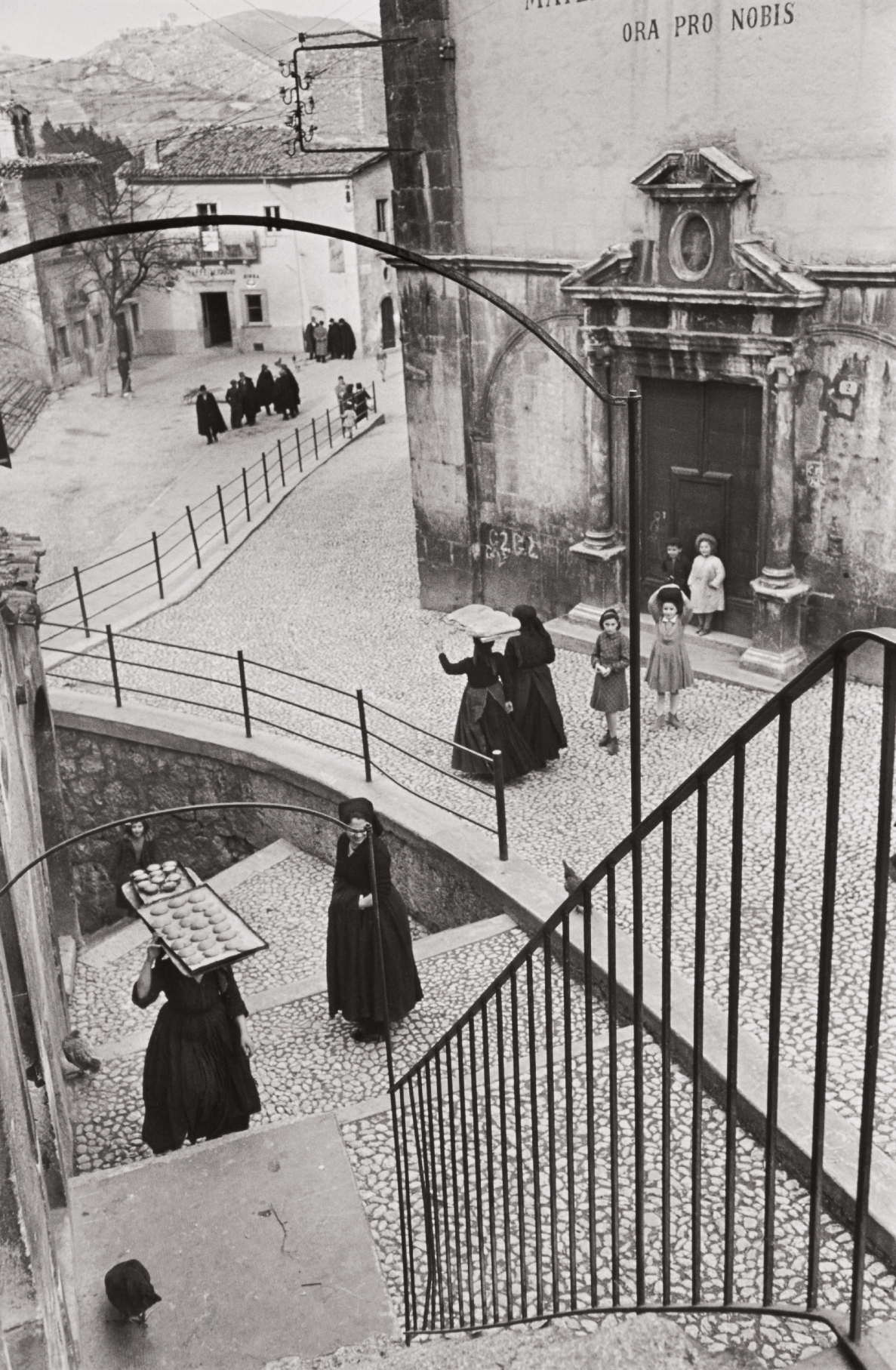 Scanno, L'Aquila, Abruzzo, Italy, a photograph that Henri Cartier-Bresson shot in 1951. This gelatin silver print was made later, however.