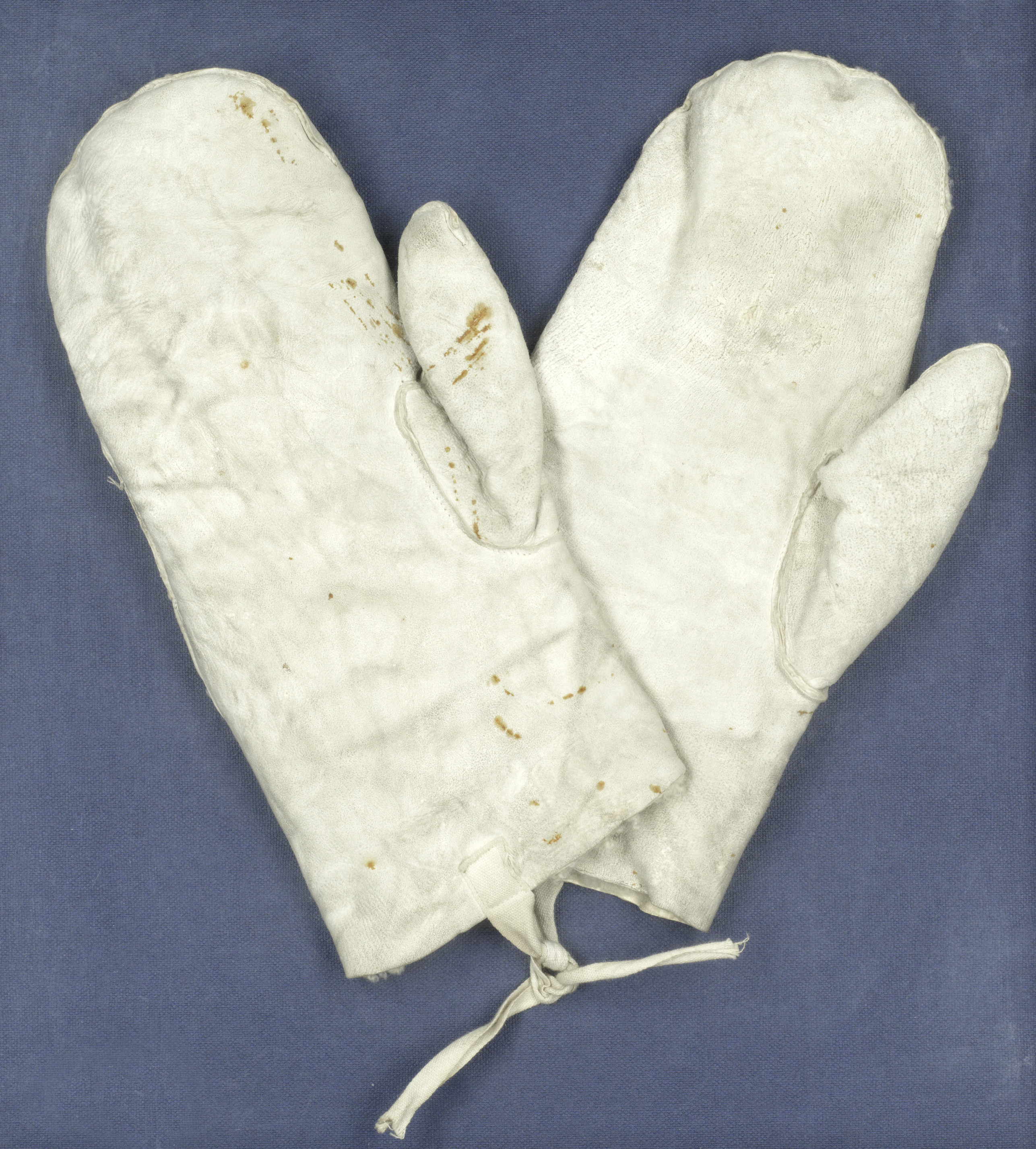A pair of lambskin inner mittens with cotton drawstrings, which belonged to British explorer Apsley Cherry-Garrard.