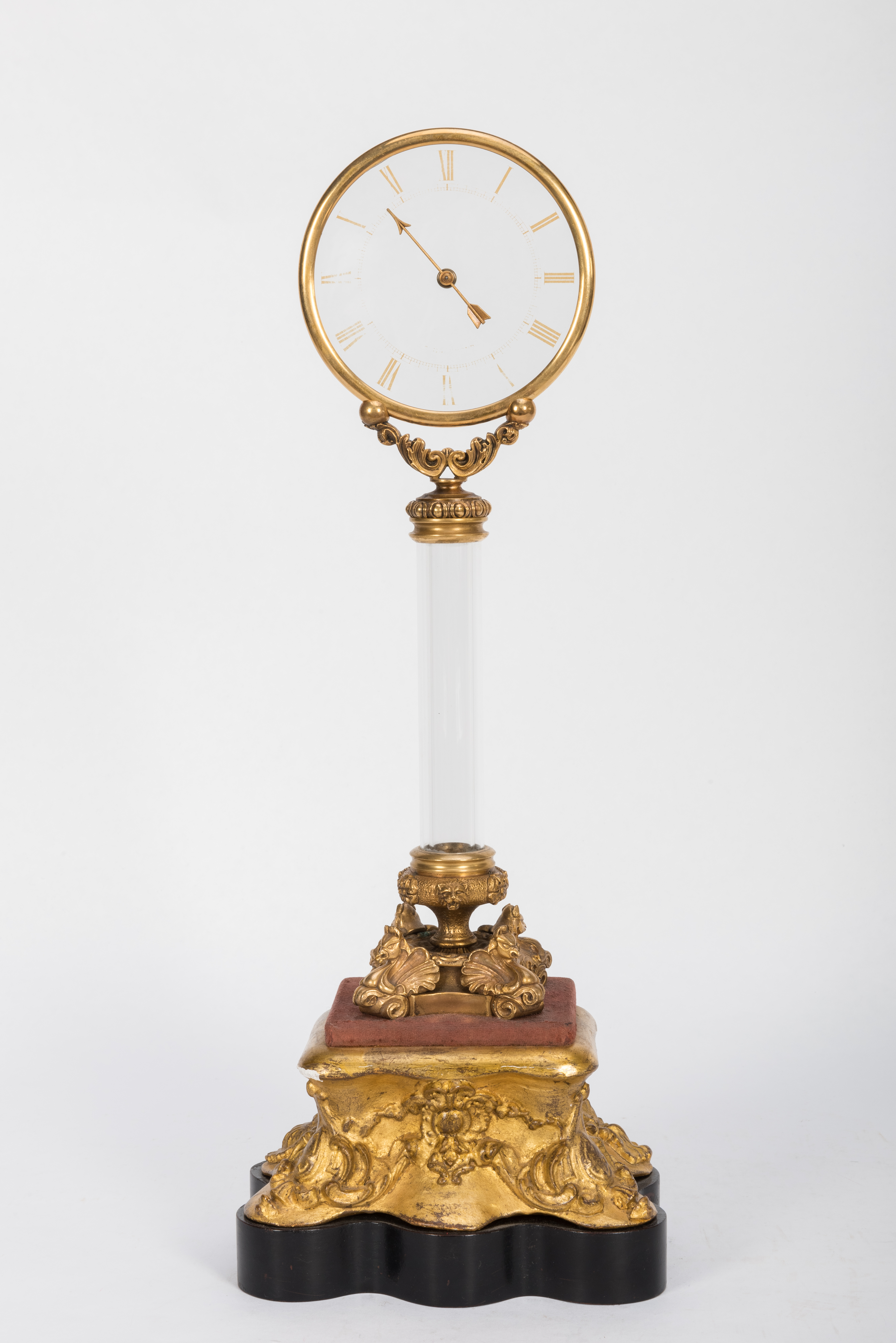 A mid-nineteenth century glass column mystery clock by Jean Eugène Robert-Houdin.