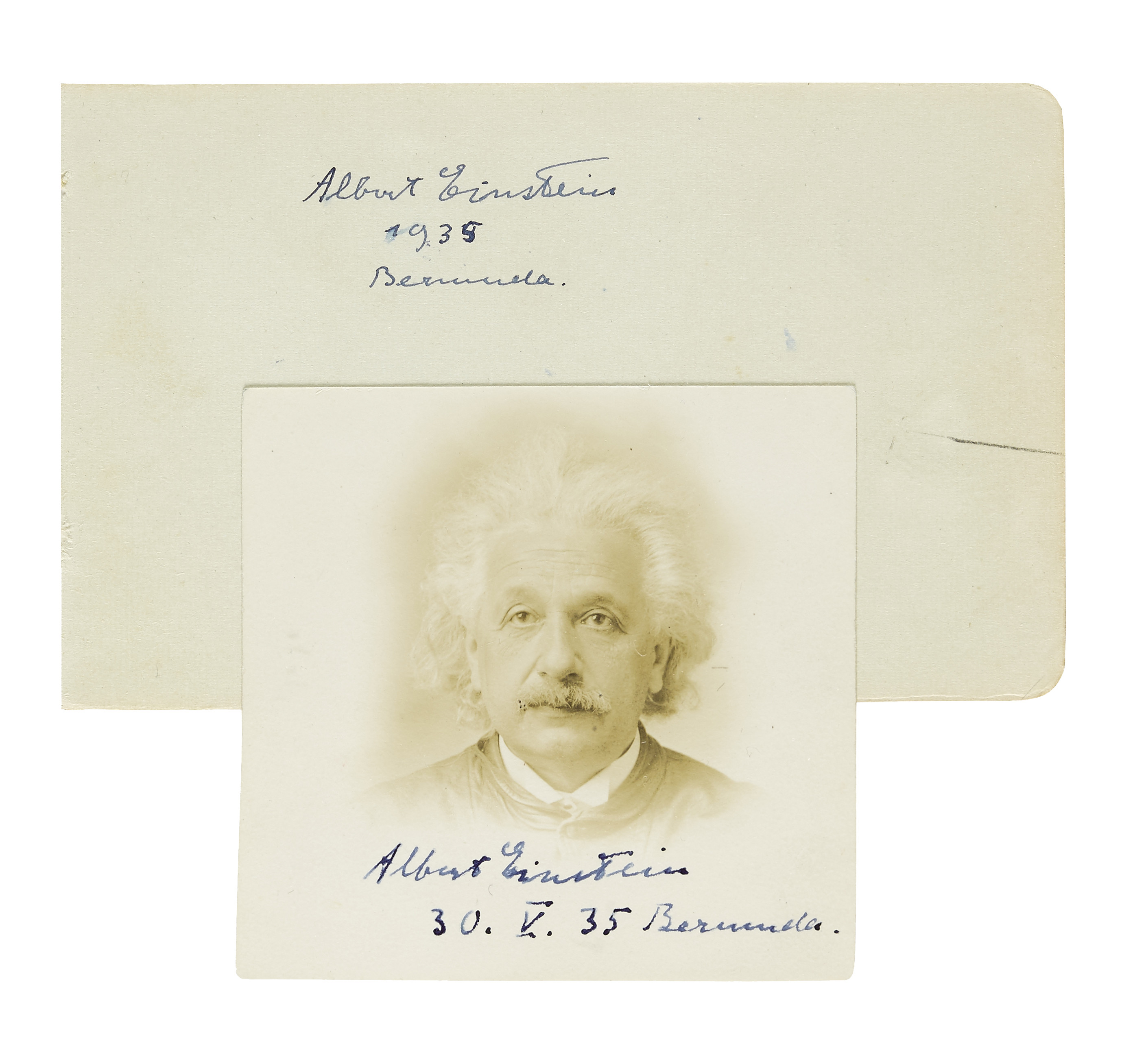 A passport photograph of Albert Einstein, signed and dated May 30, 1935, along with a piece of paper signed and dated by Einstein and featuring a brief goodbye note in German from Einstein's son-in-law, Dmitri Marianoff.