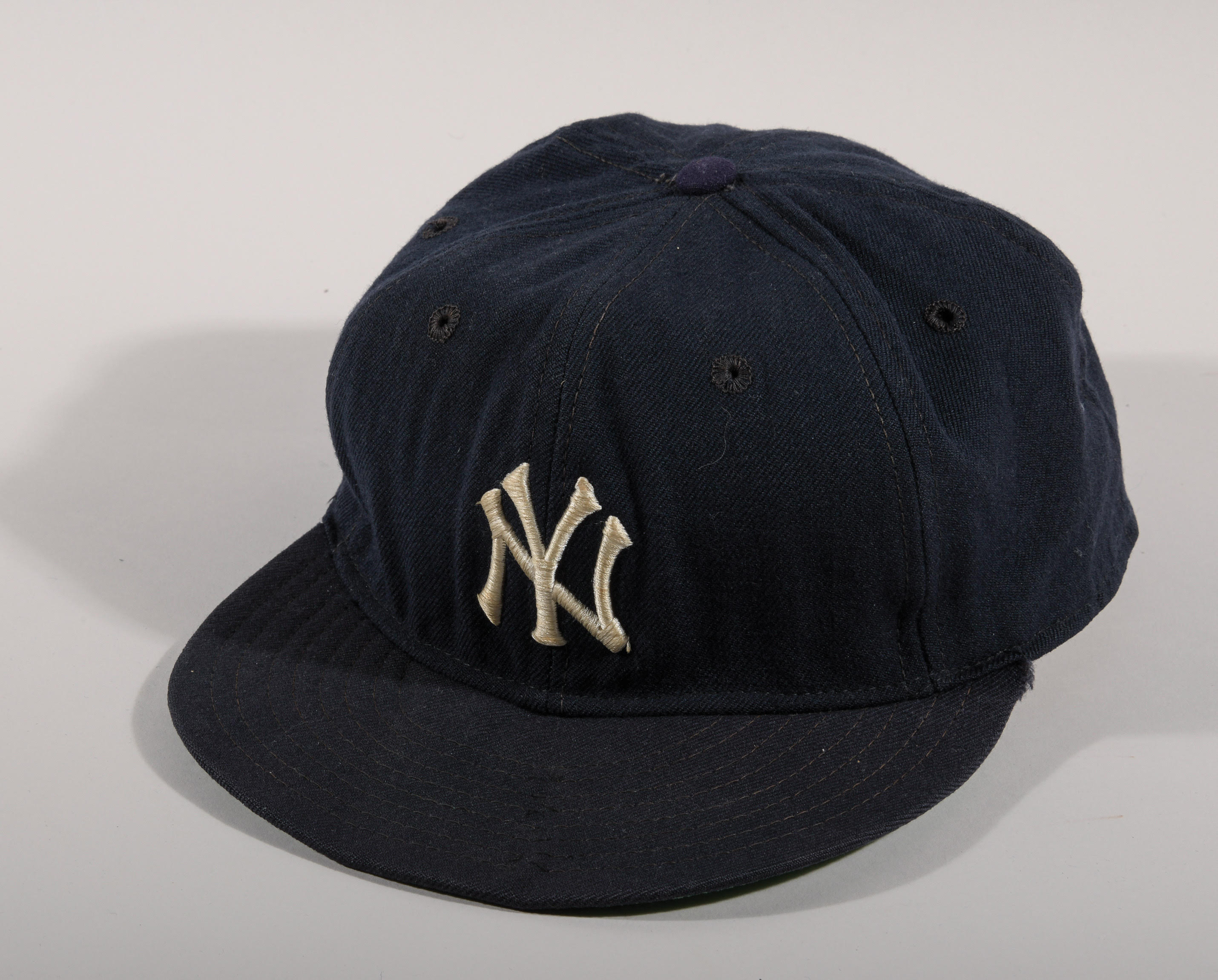 A game-worn Mickey Mantle Yankees baseball cap, circa 1968, size 7 3/4, inscribed by Mantle to his teammate, Tom Tresh. It also comes with a letter of provenance from Tresh, who died in 2008. Hunt Auctions estimates the cap at $50,000 to $100,000.
