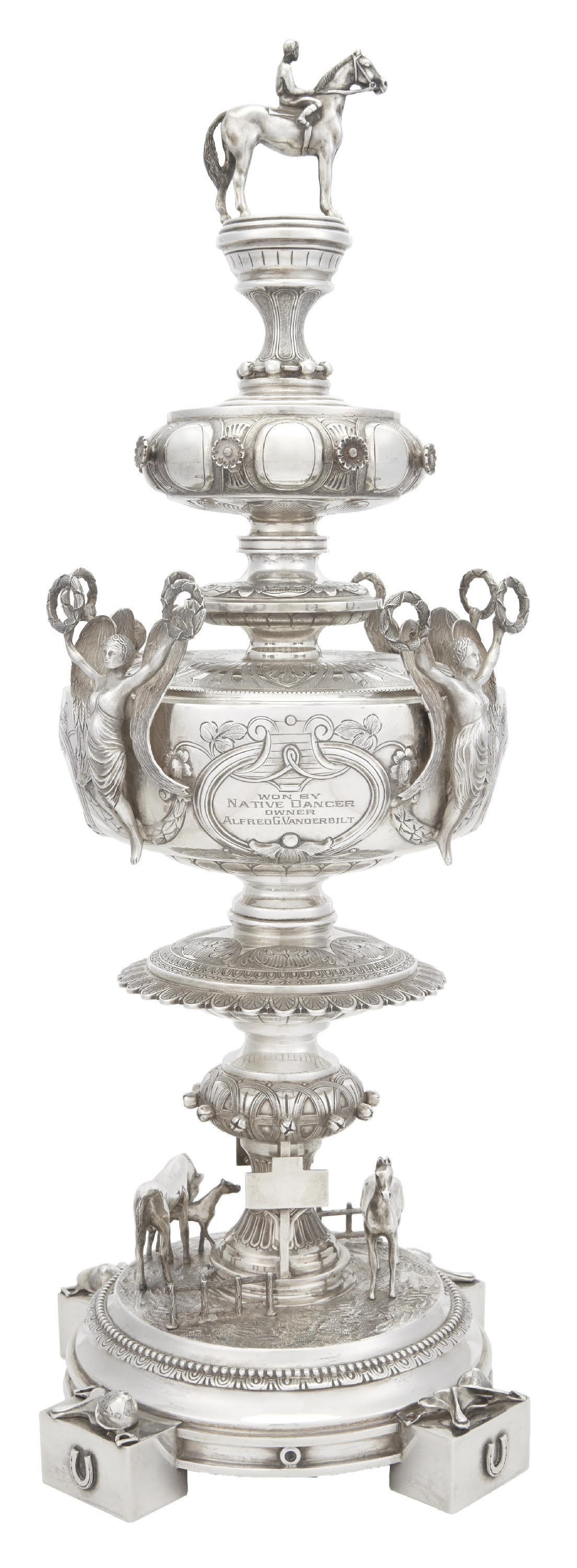 A sterling silver Preakness Trophy, won in 1953 by Alfred Gwynne Vanderbilt, Jr., owner of the thoroughbred Native Dancer. Doyle sold it in May 2018 for $100,000 against an estimate of $20,000 to $30,000, which is a world auction record for a Preakness Trophy.