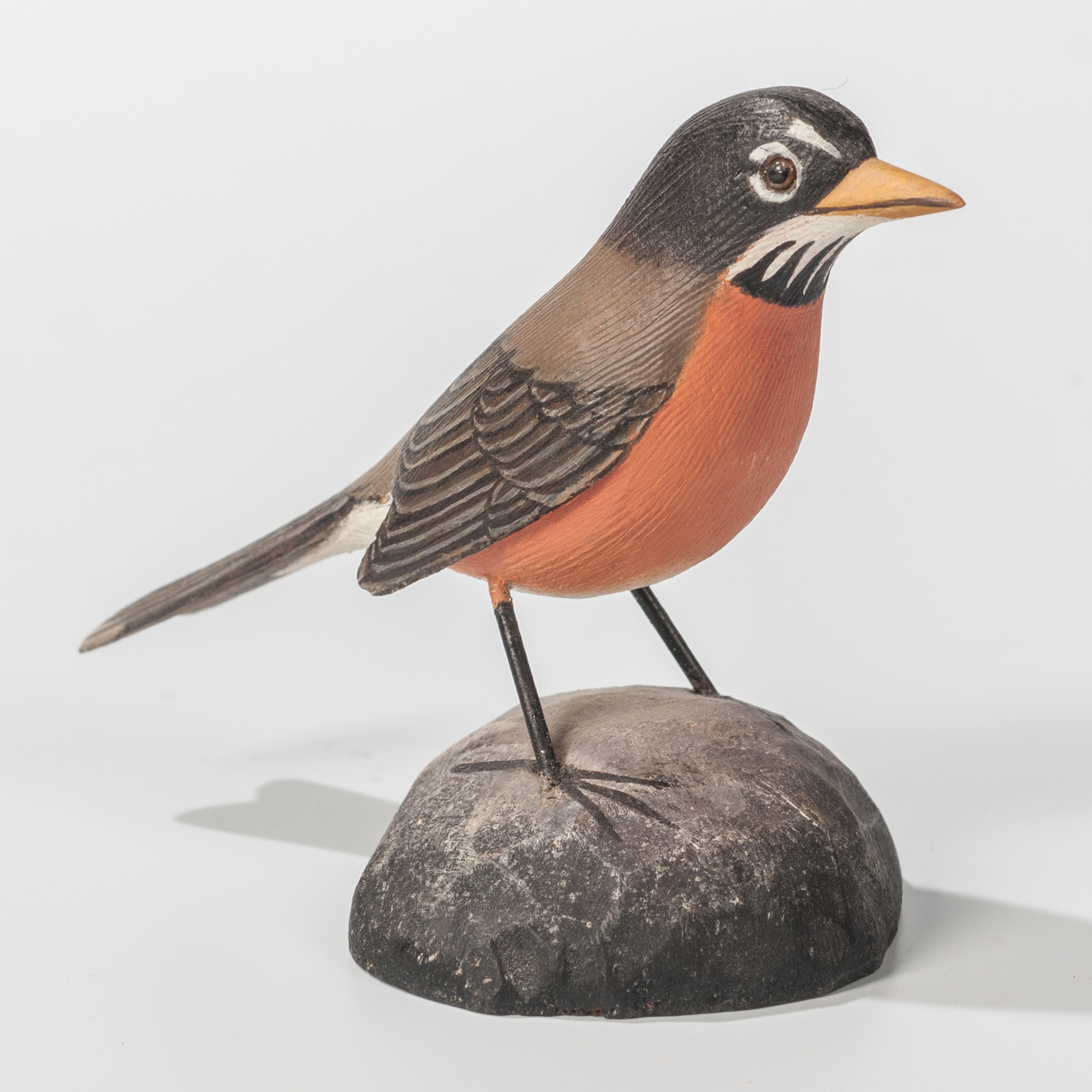 A miniature robin, carved and painted by Jess Blackstone circa 1968 or 1969.