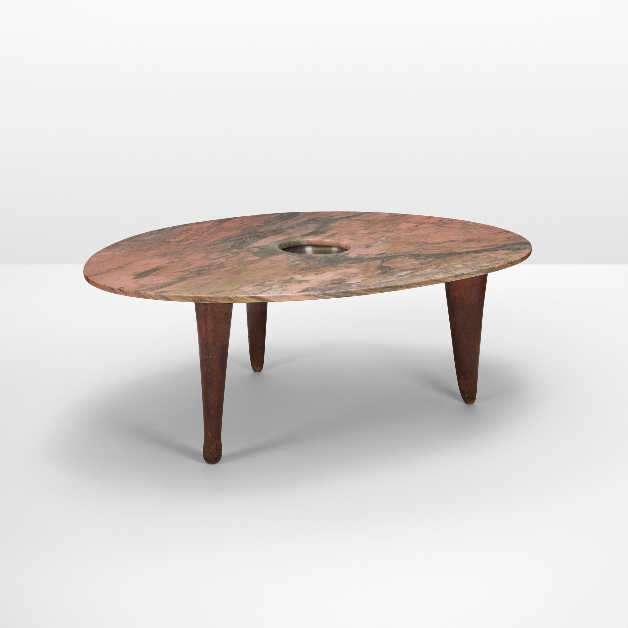 A unique pink marble dining room table designed by Isamu Noguchi for Mr. and Mrs. Milton Greene.