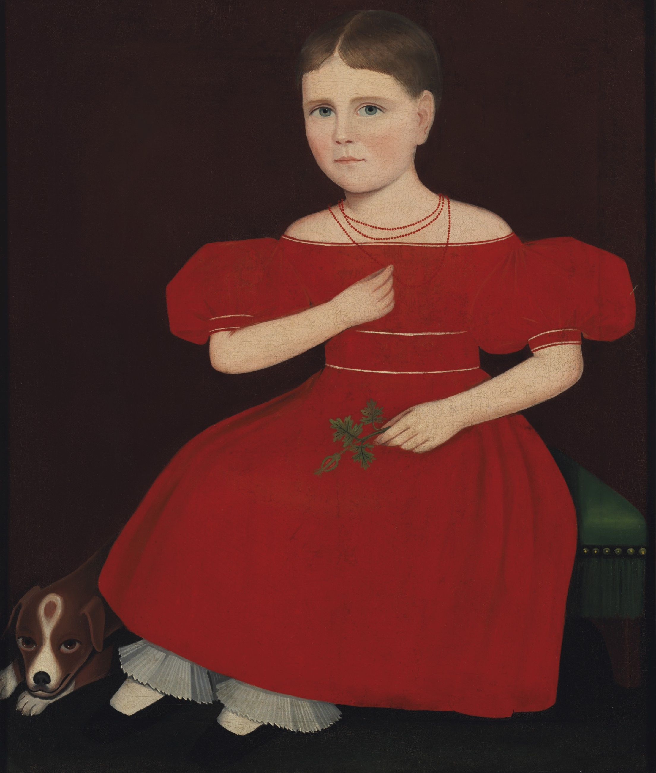 American folk artist Ammi Phillips painted Girl in a Red Dress with a Dog circa 1830-1835. The girl has short brown hair that is parted down the middle. She looks directly at the viewer. Her right hand grips one of the three strings of a coral bead necklace. Her dress is a bright, emphatic red and has short, puffed sleeves. She is shown seated on a low green ottoman. A beagle is at her feet.
