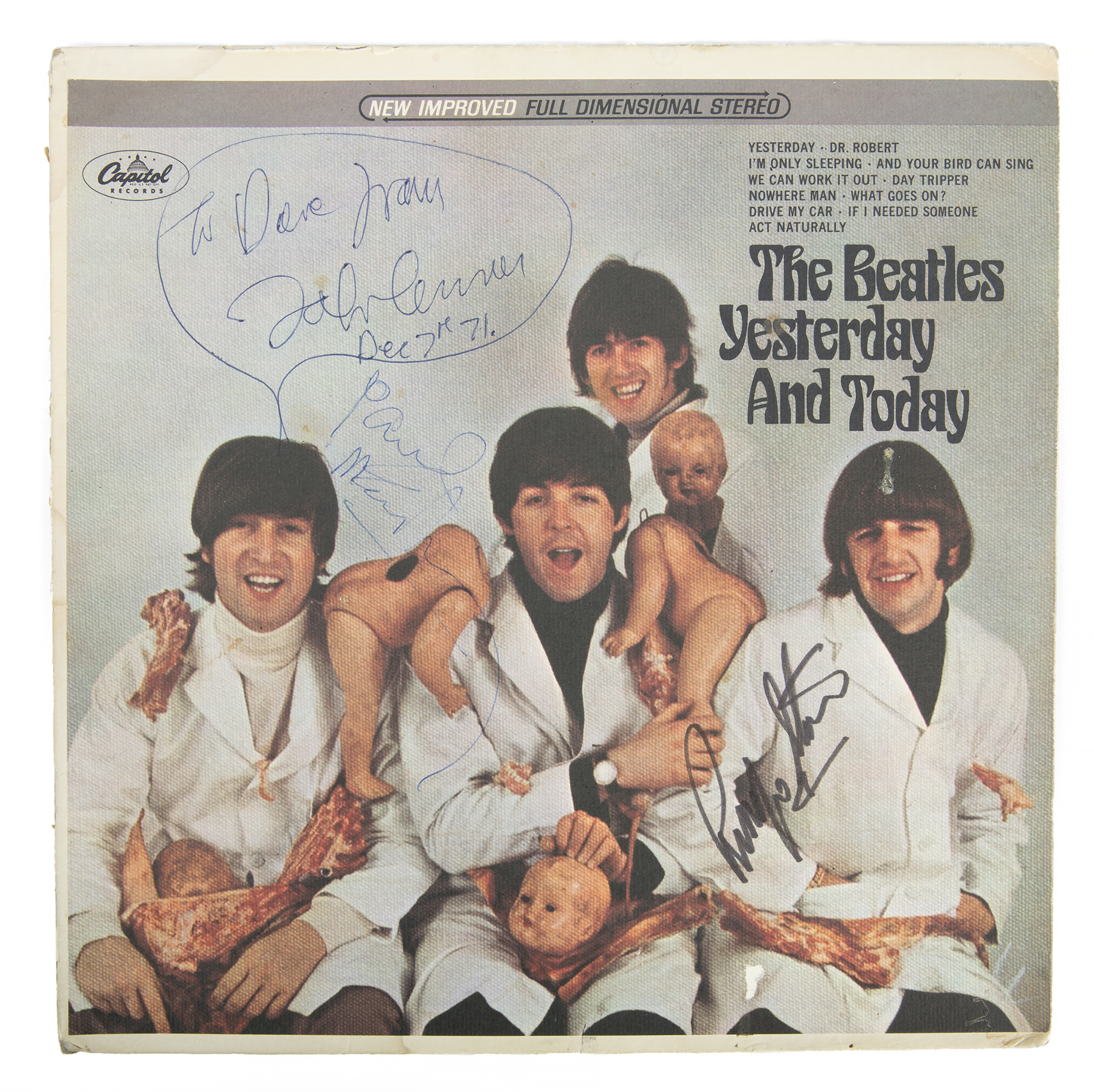 "John Lennon drew a speech bubble for the inscription on his copy of the infamous Beatles ""Butcher cover"". The image shows McCartney, Lennon, Harrison, and Starr in white lab coats and draped with dismembered dolls and raw meat. McCartney signed it below Lennon's speech bubble. Starr signed the area over his right shoulder."