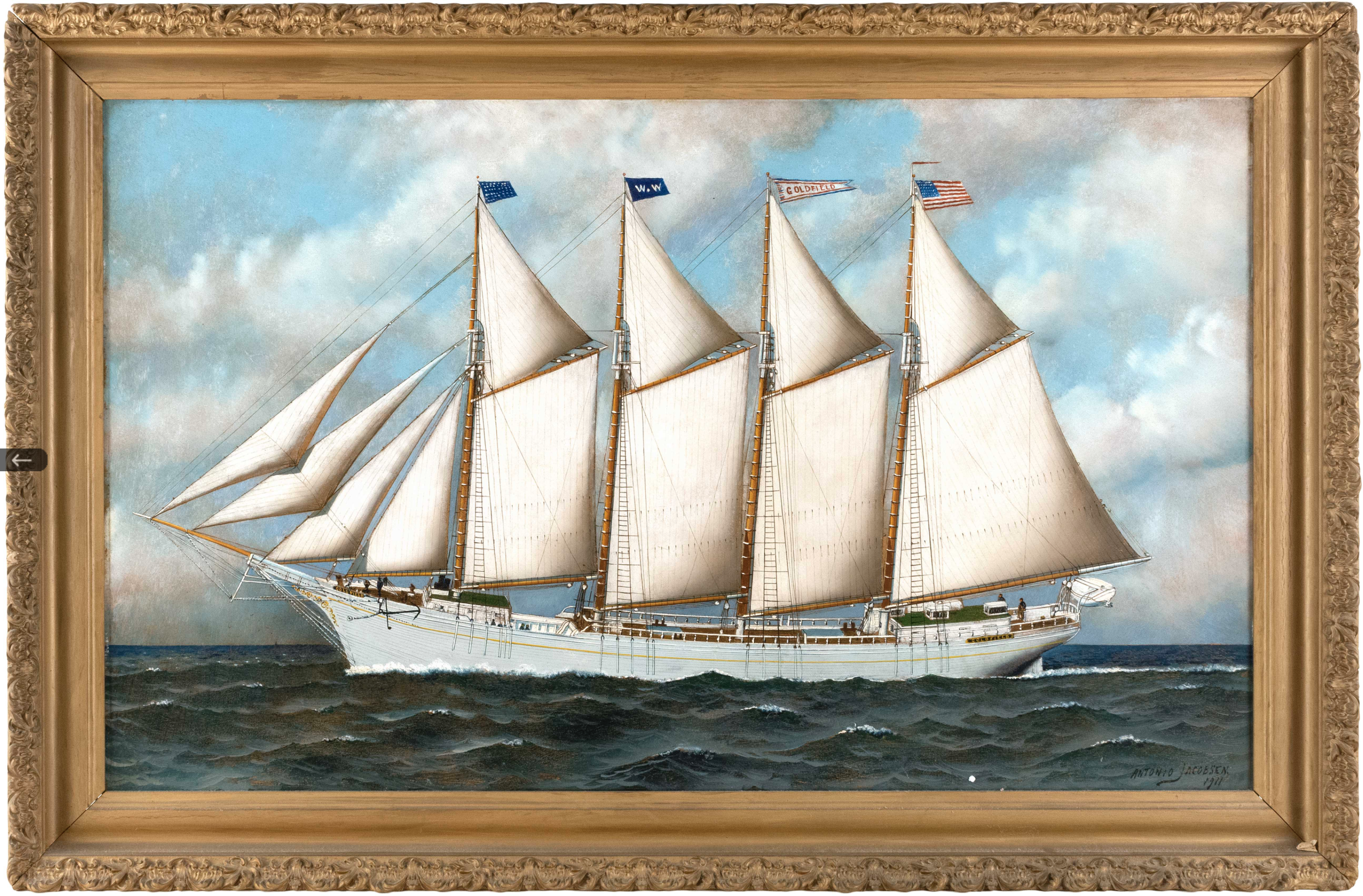Antonio Jacobsen's 1911 portrait of the schooner dubbed Goldfield depicts the white-bodied vessel in profile, prow to the left. Its four masts are topped by, respectively, an American jack, a line flag, a flag with the ship's name, and the American flag.