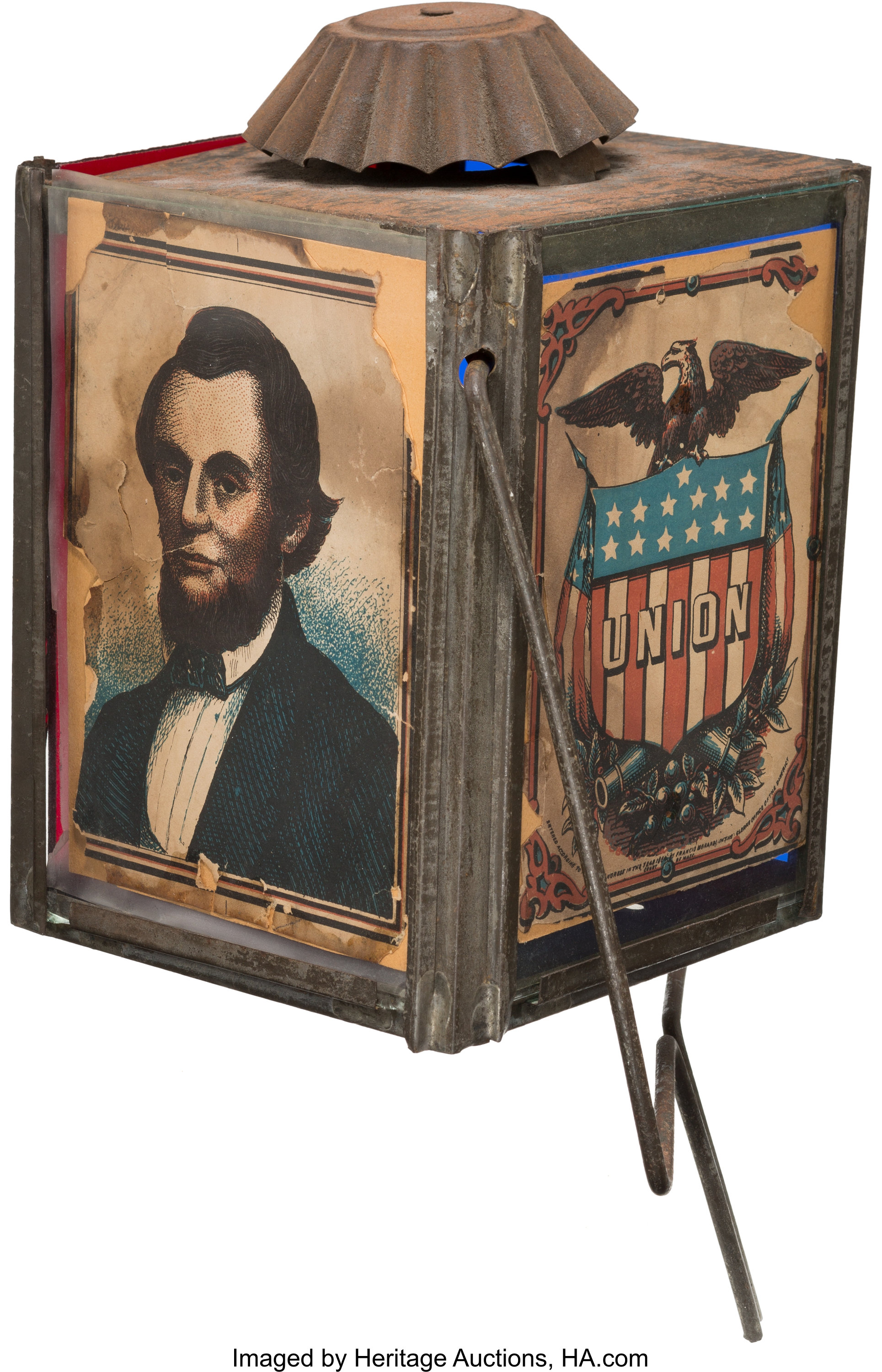 "This rare circa 1860s parade lantern features an image of Abraham Lincoln on one panel and a spread-winged eagle sitting on a shield with the word ""union"" on it."