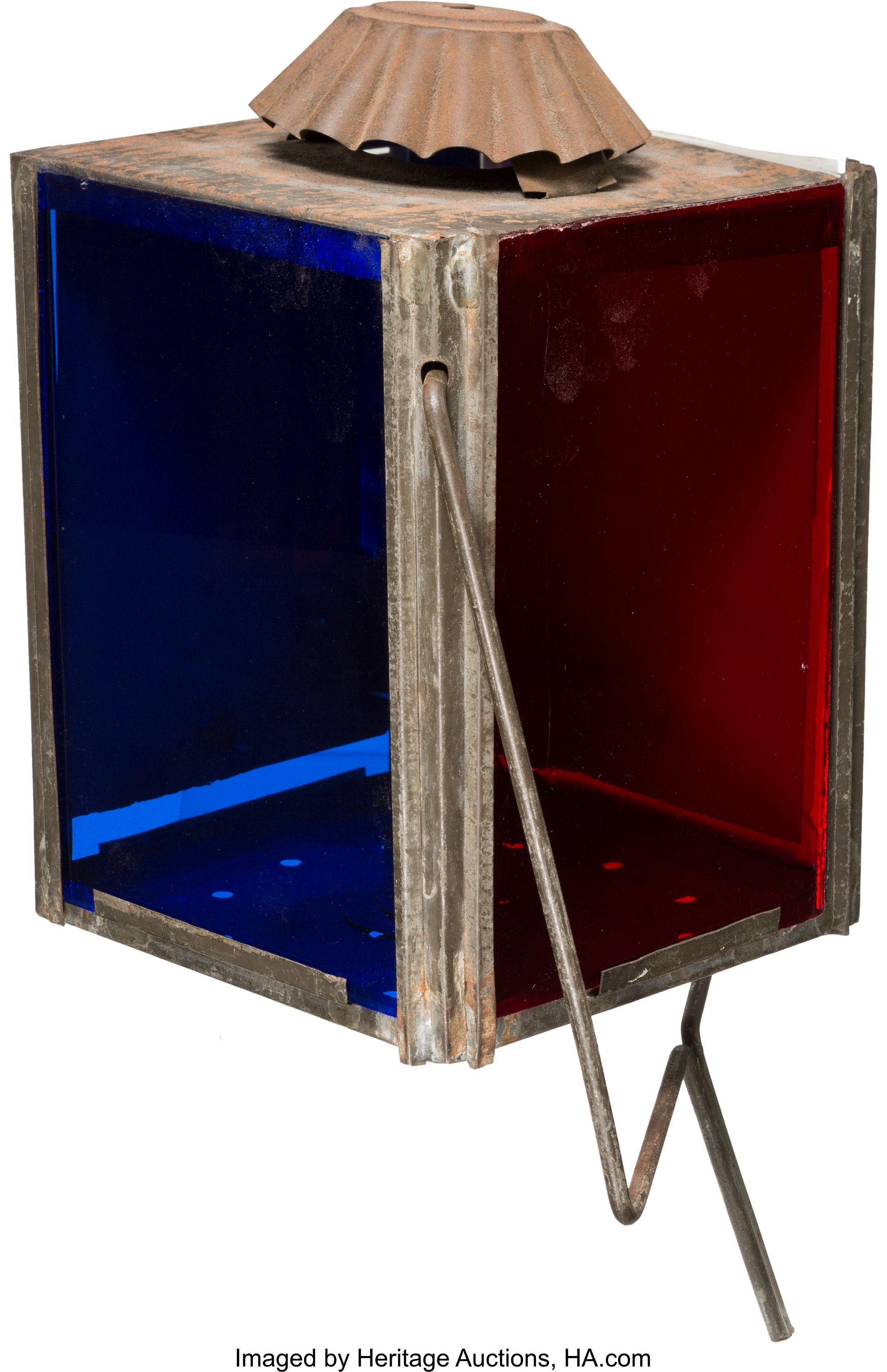 The rare circa 1860s campaign parade lantern for Abraham Lincoln, showing the other two sides of the four-sided object. One is entirely blue, and the other is entirely red.