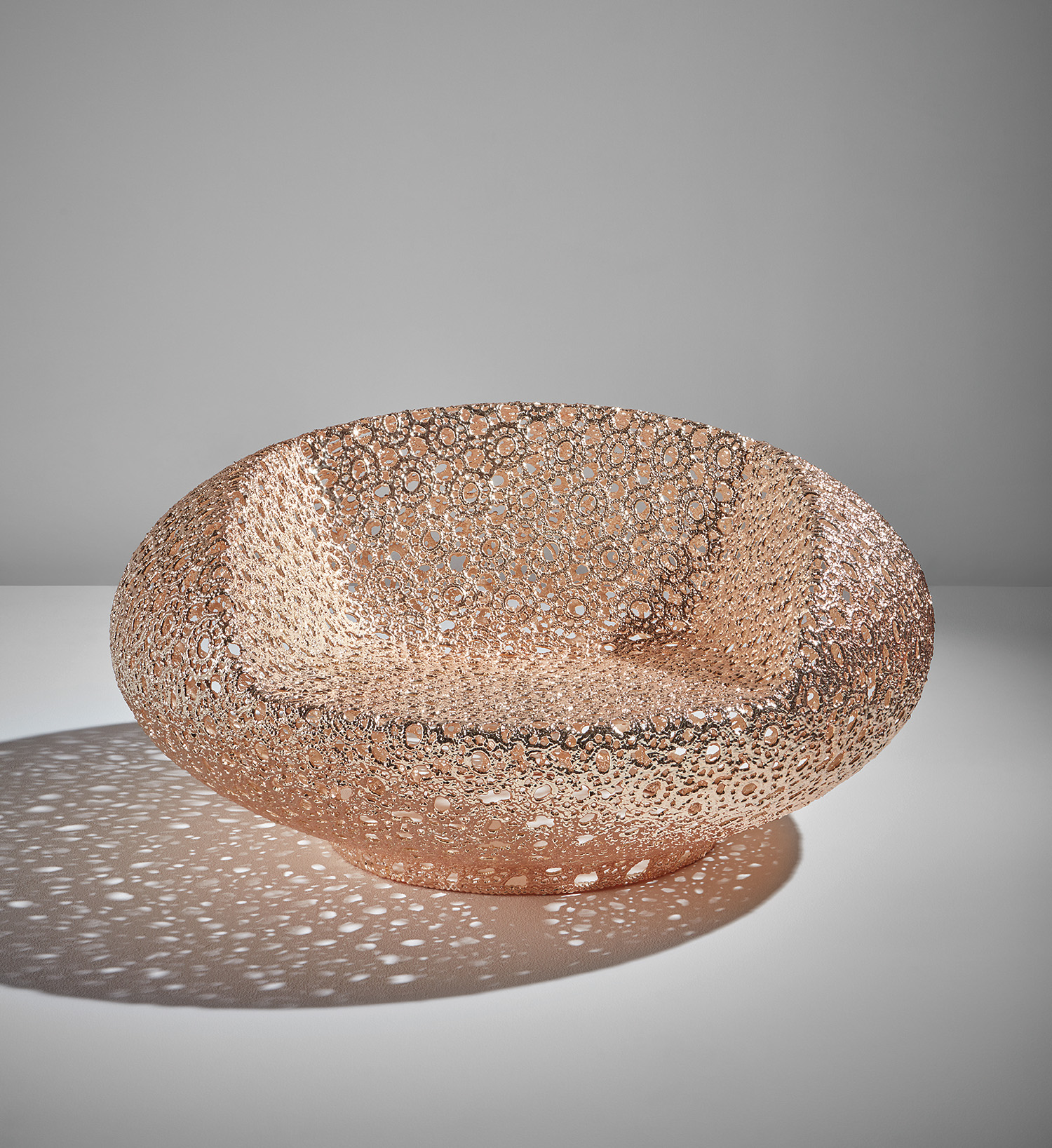 "A Marcel Wanders gold limited edition ""Bon Bon"" chair, fashioned from hand-crocheted rope impregnated with epoxy. It is light and ethereal-looking."