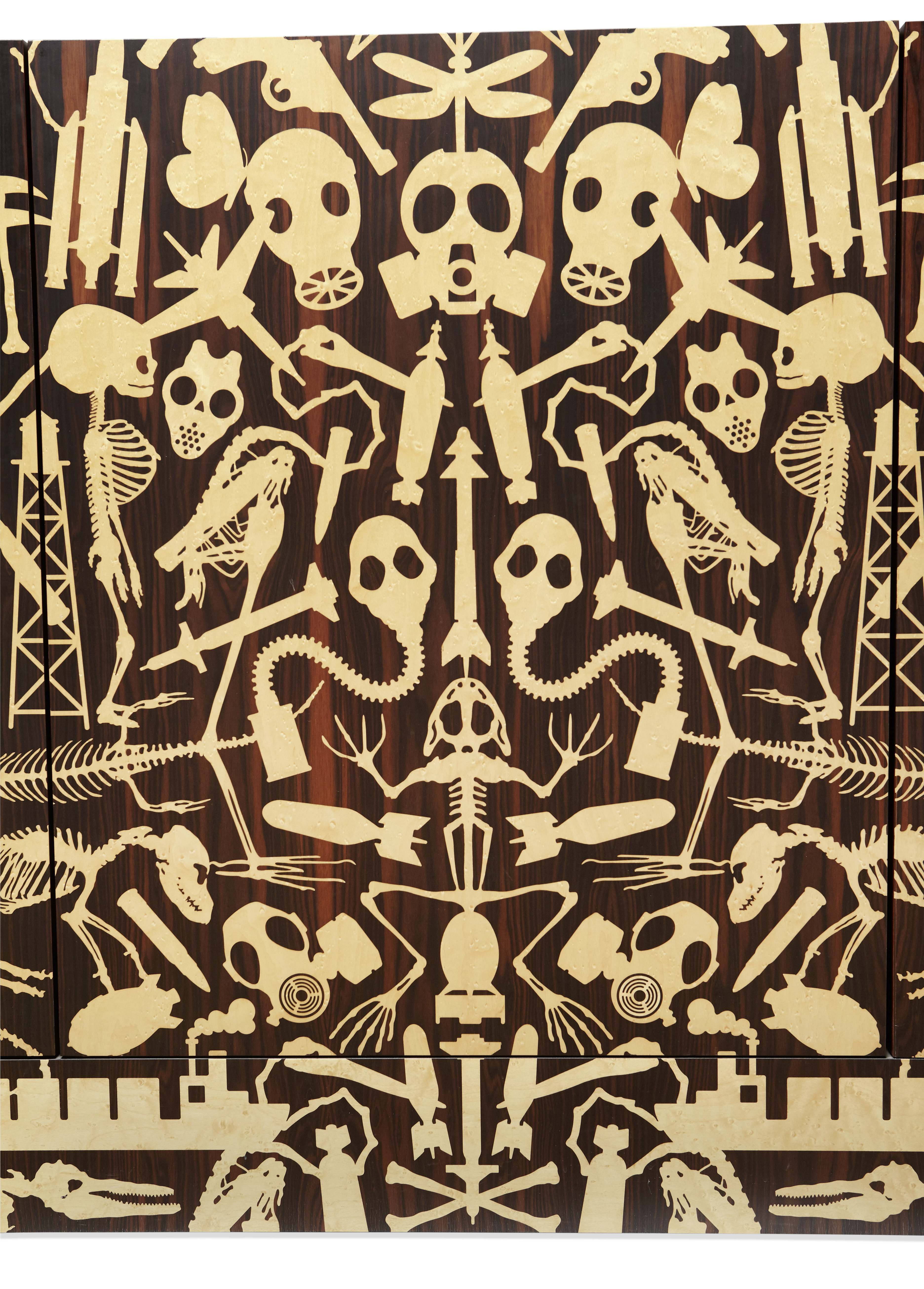 "A detail of the unique ""dressoir"" made by Studio Job in 2006 that combines imagery from its Perished and its Industry series. It is tightly crowded with bird's eye maple images of skeletons, bombs, butterflies, and gas masks on a Macassar ebony background."
