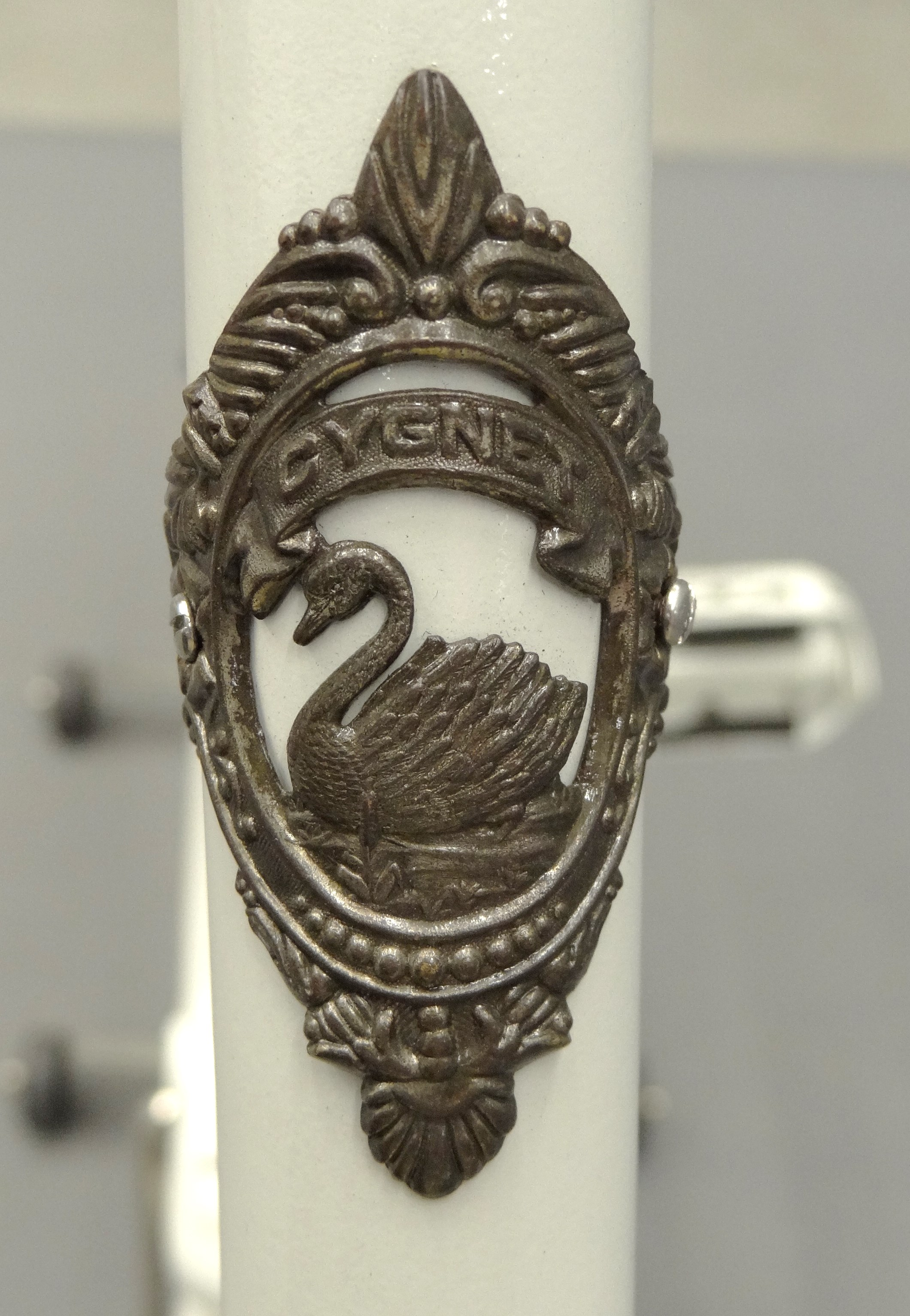 "A close-up of the brand badge on the 1898 Cygnet ""Swan"" Ladies pneumatic safety bicycle."