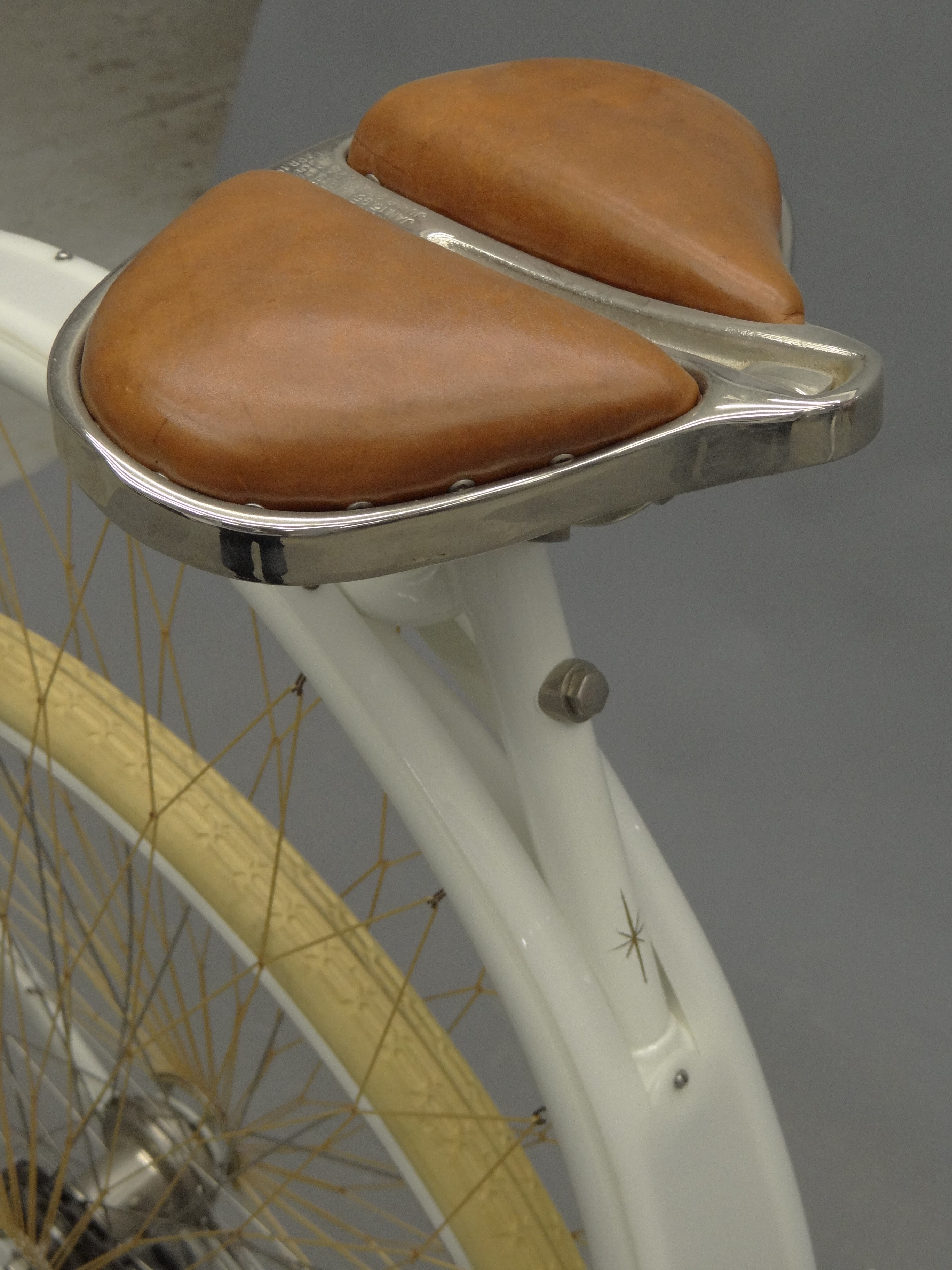 "Detail shot of the seat of the 1898 Cygnet ""Swan"" Ladies pneumatic safety bicycle."