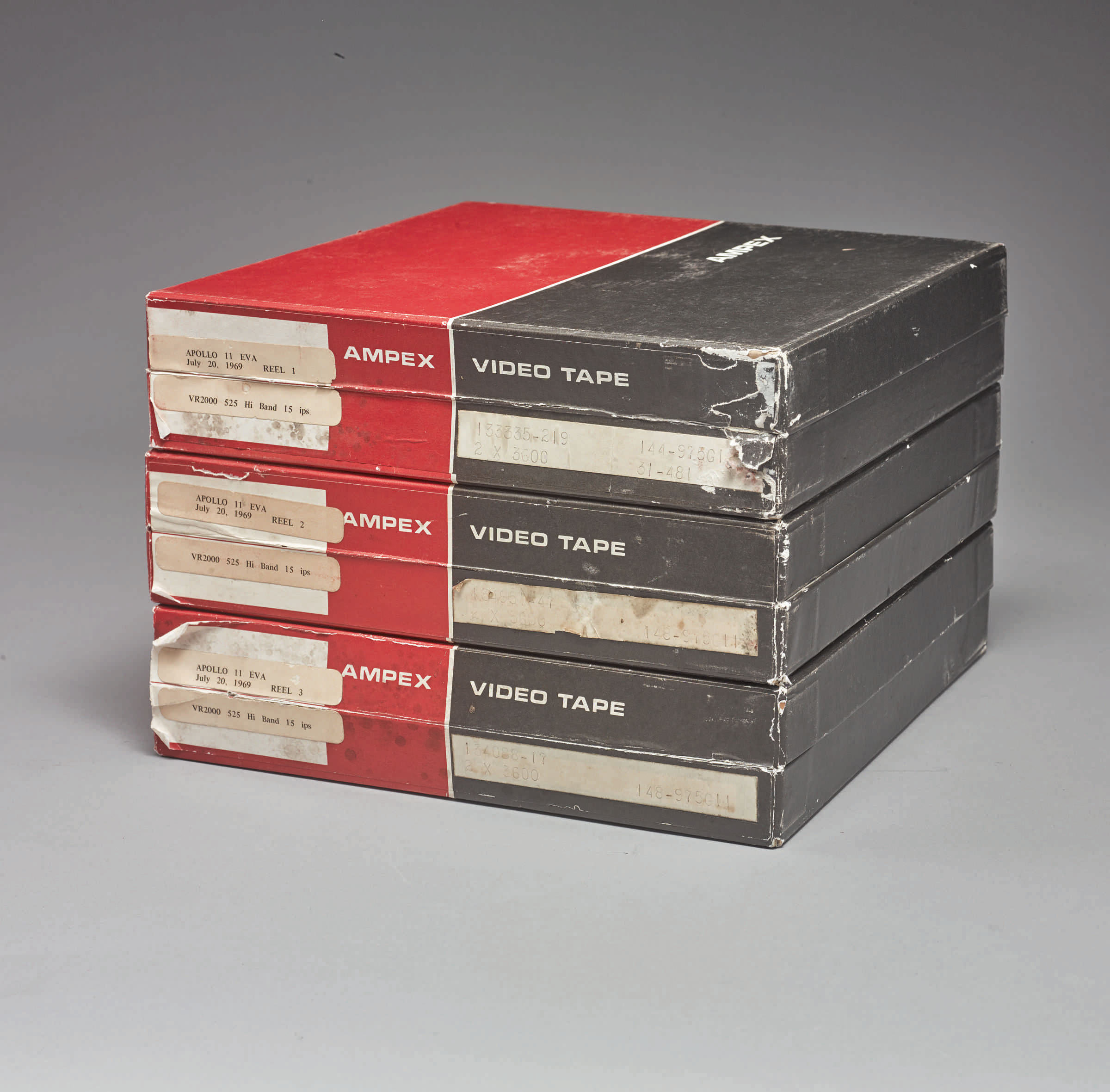 A stack of three AMPEX tape boxes containing original, first-generation NASA recordings of the Apollo 11 moon walk.