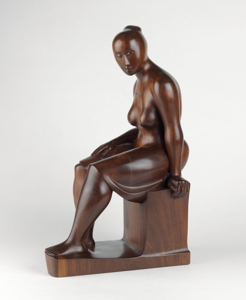 Elizabeth Catlett's 1962 mahogany sculpture, Seated Woman, set a record for the artist at Swann Auction Galleries in 2019.