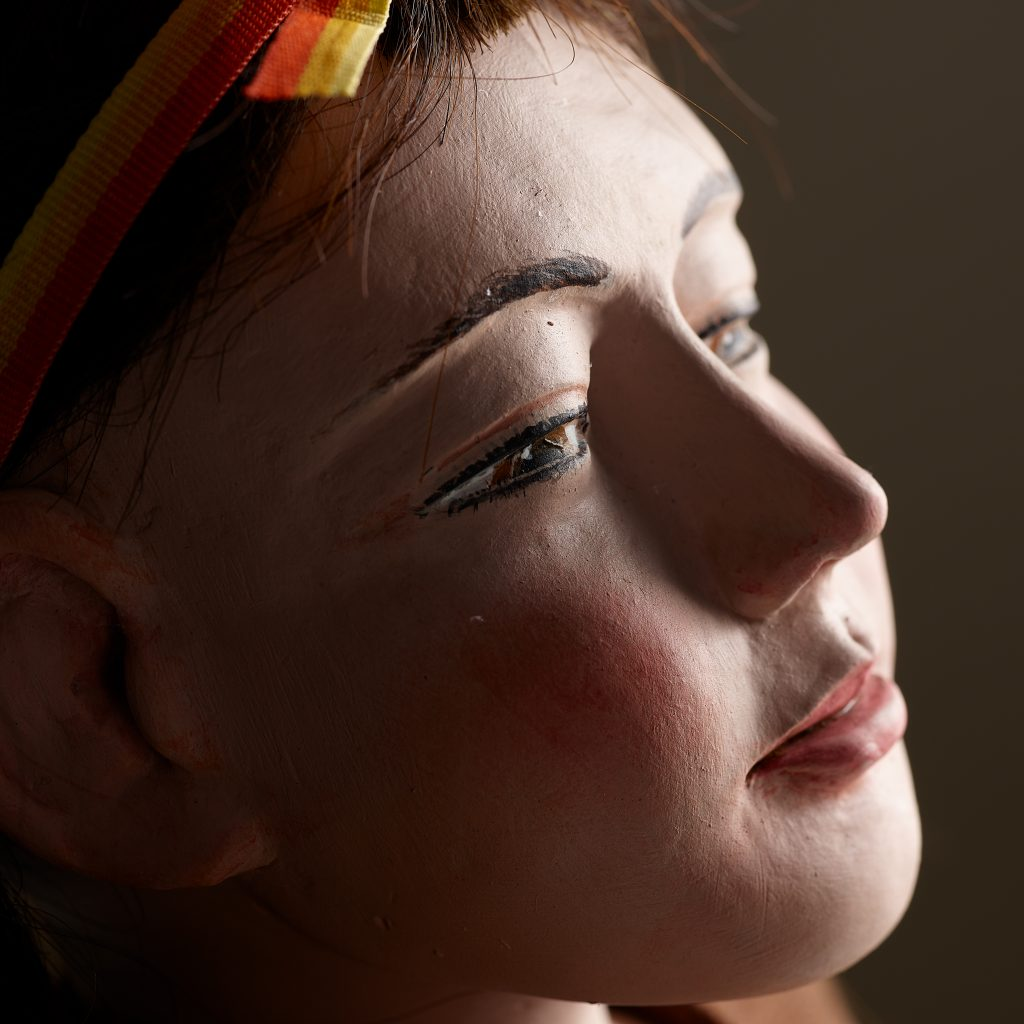 A closeup, in profile, of the face of the Daydreaming Girl figure.