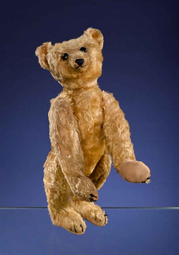 A Steiff PB28 rod bear, created circa 1903 or 1904. When measured in a standing position, it tops out at 15 and 3/4 inches tall.