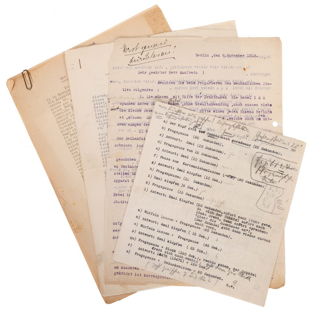 Paperwork, written in German, that accompanies the Willmann talking skull automaton. It describes the workings of the trick and references a less deluxe version of the automaton.
