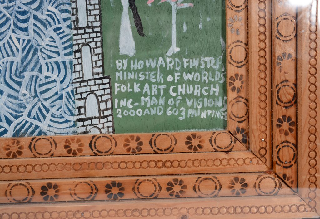 A detail of Vision of George on Planet Loraleon, a painting by the late American self-taught artist Howard Finster, which shows the decorations he burned into the frame he made for the work.
