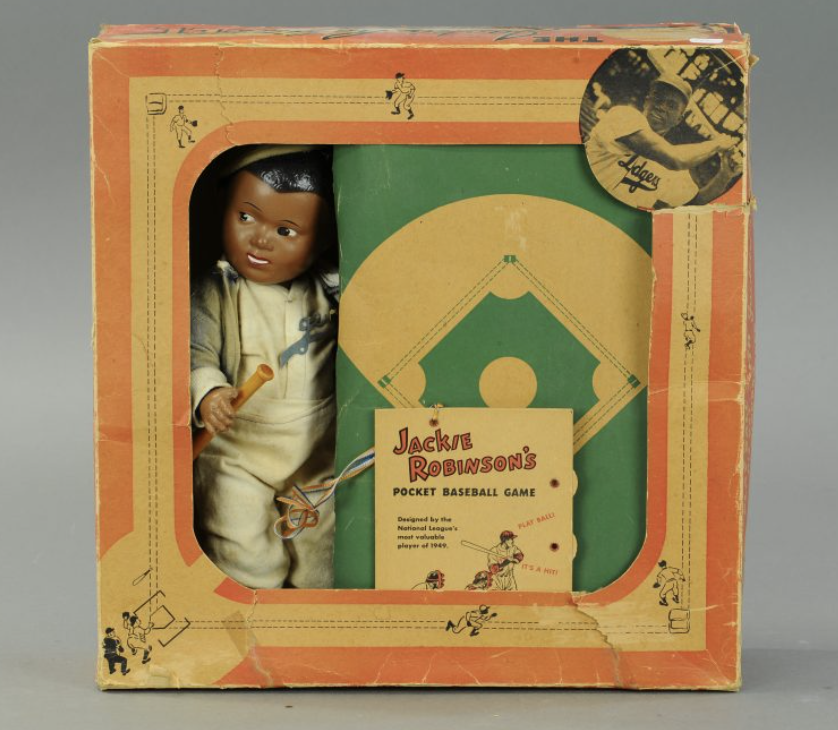 A circa 1950s Jackie Robinson doll in its original box. The Dodgers legend is pictured in the upper right corner.