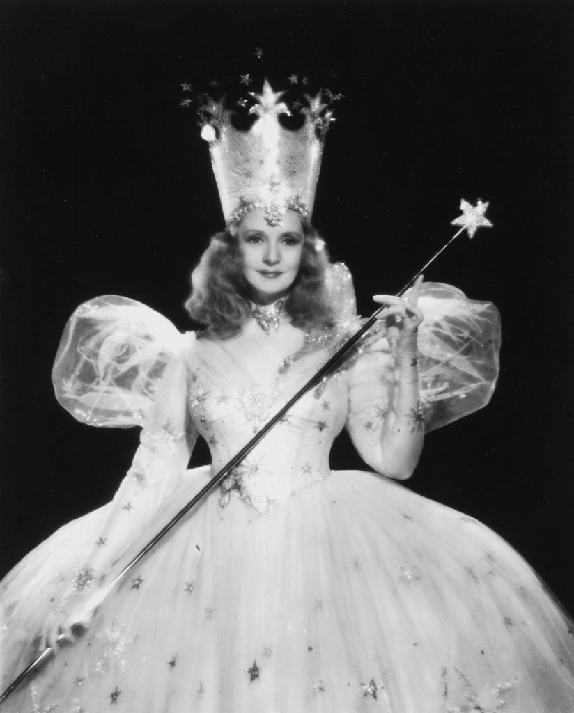 A period publicity shot of Billie Burke as Glinda the Good Witch, holding the test wand that is now up for auction.