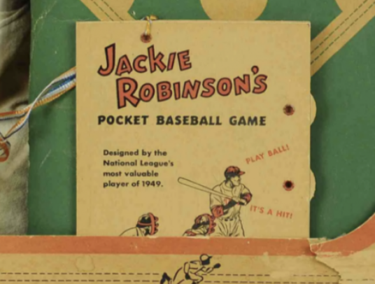 Closeup of the Jackie Robinson pocket baseball game that comes with the circa 1950s doll.