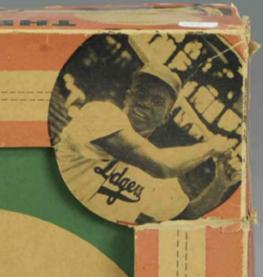 A closeup on the black-and-white photo of Jackie Robinson on the packaging for the doll.