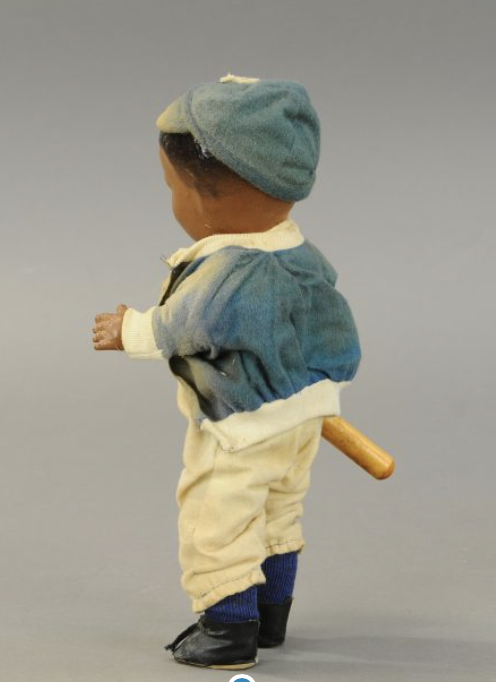 Another angle on the Jackie Robinson doll, shown in full from the left rear.