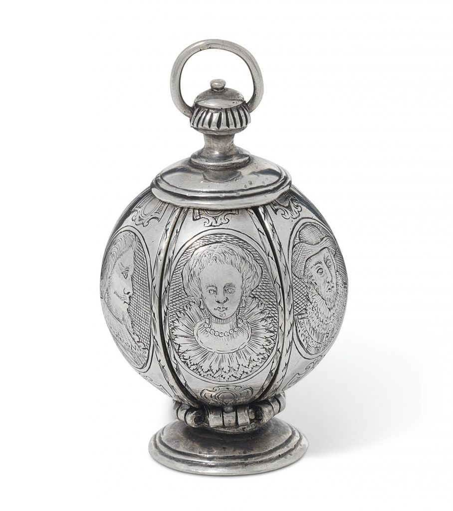 An Elizabeth I-era silver pomander, early 17th century, featuring six engraved royal portraits. The woman in the center was initially identified as Queen Elizabeth I. Scholars now think she is either Anne of Denmark (wife of James I, who is shown on the right) or a queen of Bohemia. The bearded man on the left is believed to be King Charles I depicted as the Prince of Wales.