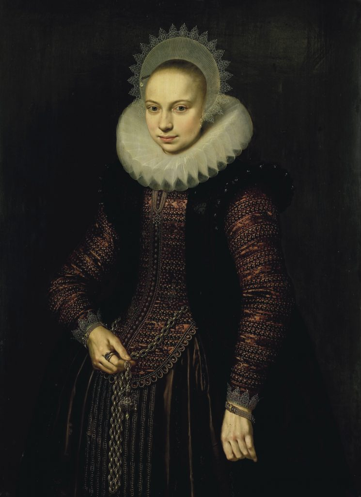 A Dutch period full-length portrait of a woman wearing a pomander on a chatelaine.