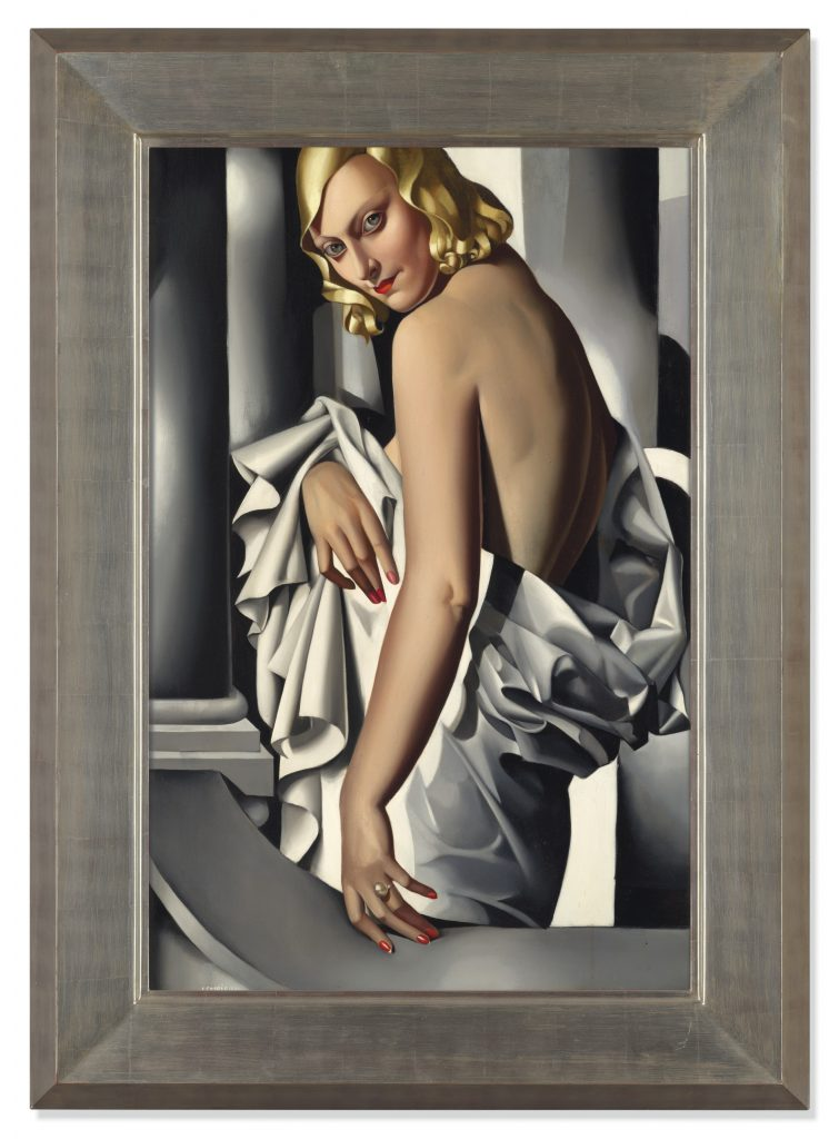 Portrait of Marjorie Ferry, a 1932 painting by Tamara de Lempicka, features a blond woman in loose white drapery looking over the shoulder at her viewer.