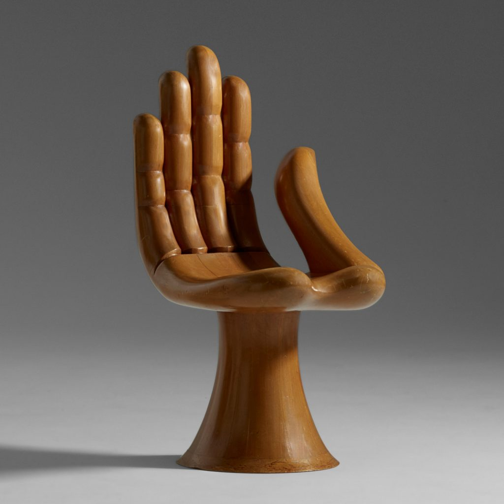 A Pedro Friedeberg Hand chair in unadorned mahogany, dating to circa 1965. It, too, could sell for $9,000 or more at Rago.