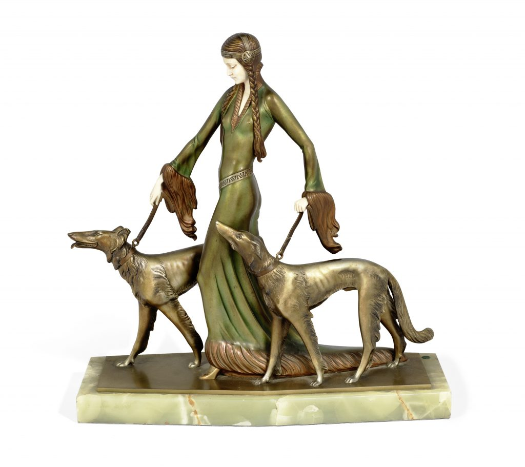 A Professor Otto Poertzel Art Deco figure, dubbed The Aristocrats and depicting a woman in medieval-esque clothing walking a pair of Borzoi dogs.