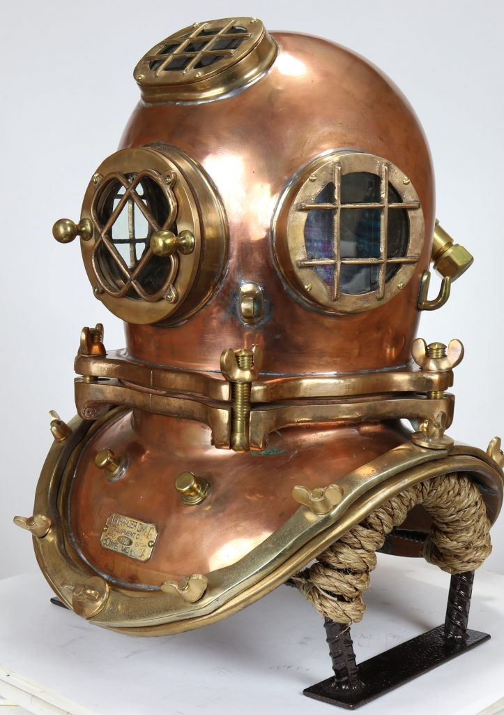 "A full three-quarter view of the Schrader diving helmet. It's called a ""four light"" model because it has four lights, or windows. The one installed at the top was an option that cost $10 extra."