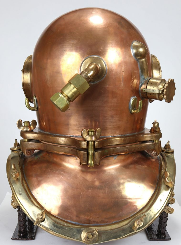 A rear view of the Schrader diving helmet with the all-important non-return valve visible at the center back.