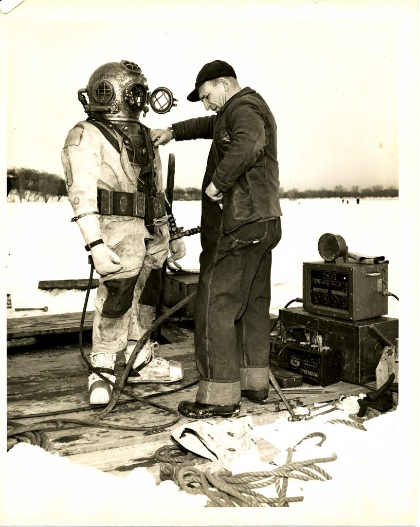 Don Creekmore's collection includes this circa 1940s newspaper photo, which he kindly shared. While the diving helmet is not a precise match for the Schrader five-bolt, it illustrates how pre-modern diving equipment was worn and used.