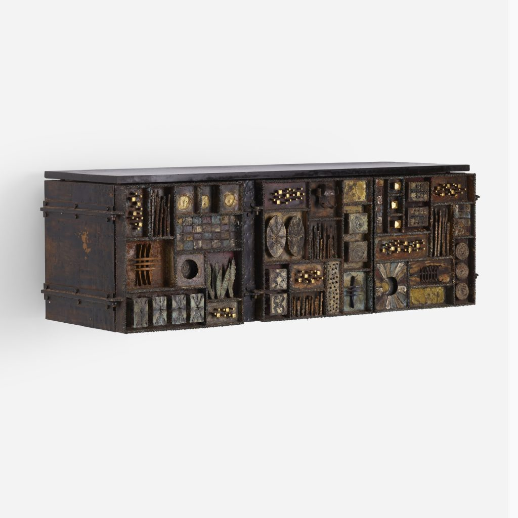 A Paul Evans sculpture front cabinet, created in 1975. The slate-topped Brutalist marvel could sell for $150,000 or more at Rago in May.