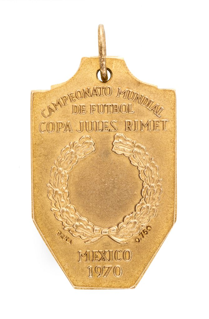 The front of the World Cup winner's medal awarded to Pelé in 1970. It sold for more than $400,000 in 2016, setting records for any Pelé item and any football or soccer medal.