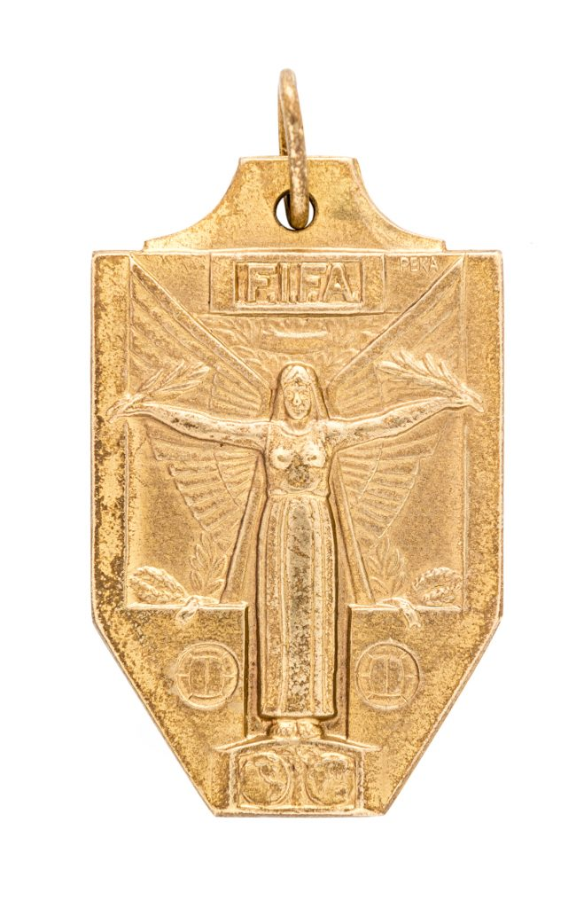 The reverse side of the World Cup winner's medal that was awarded to Pelé in 1970. It represents his third World Cup win, and 50 years later, he's still the only player, male or female, to propel the winning team to victory three times.