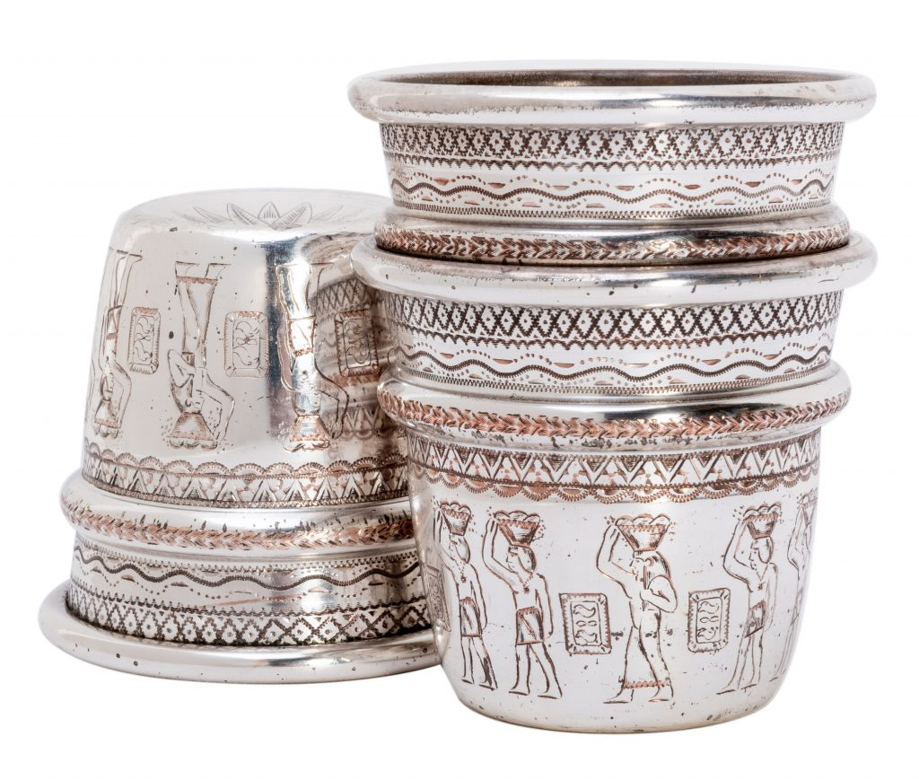 Johnny Thompson's cups were originally all-copper, but he had them silver-plated and engraved with images of Egyptian hieroglyphs.