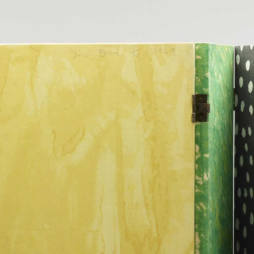 A detail shot of the Jim Dine screen, showing his signature on the yellow panel.