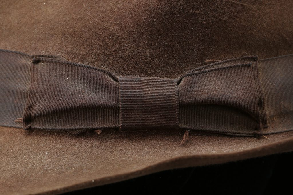 A close-up on the bow on the Indiana Jones hat. Its particular shape and stitching helps experts identify when and in what scenes Ford wore it.