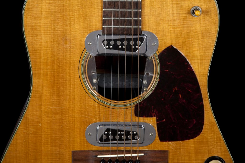 A close-up on the 1959 Martin D-18E guitar that shows the Bertolini pickup Kurt Cobain added to it (it's visible inside the sound hole).