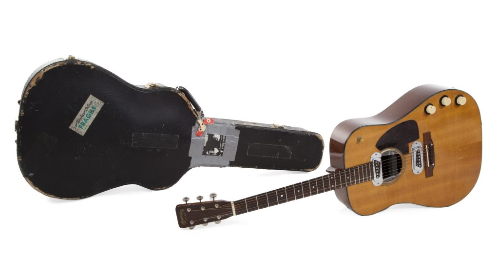 A shot of the vintage Martin Kurt Cobain owned, alongside its hard shell case.